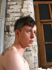 Pale, skinny and pierced cutie Brad Holt works a big, fat uncut cock through a gloryhole