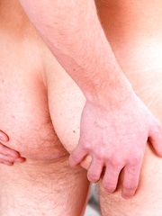 Rosy cheek twink Pat Drone stroking his uncut cock.