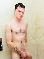 New hung lad Tommy Brookes strokes out a load in the bathroom before his interview
